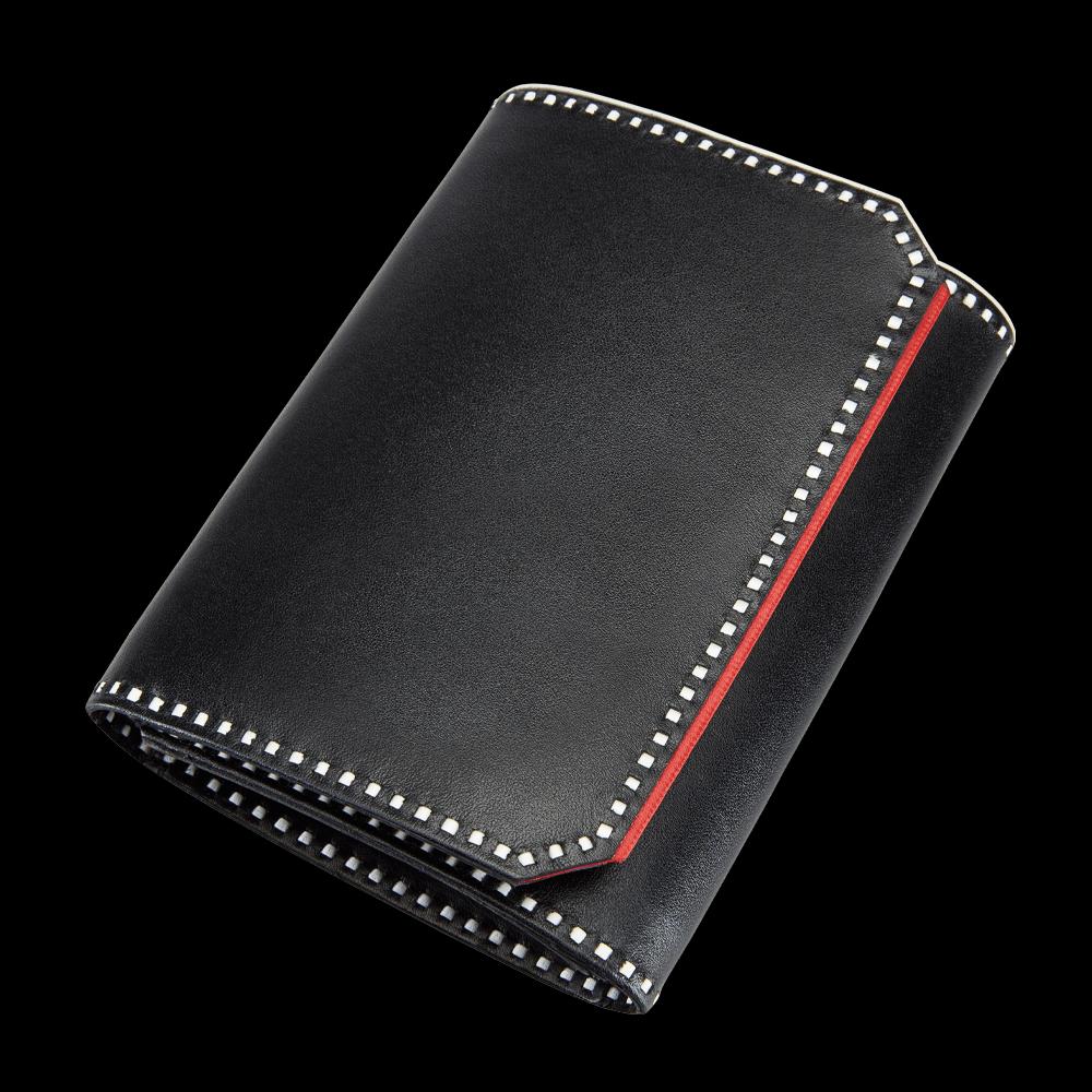freigestellte produktfotografie accessoires schwarze geldtasche für onlineshop